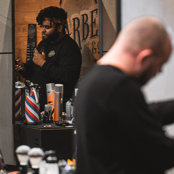 Barbers at Barber & Co cutting