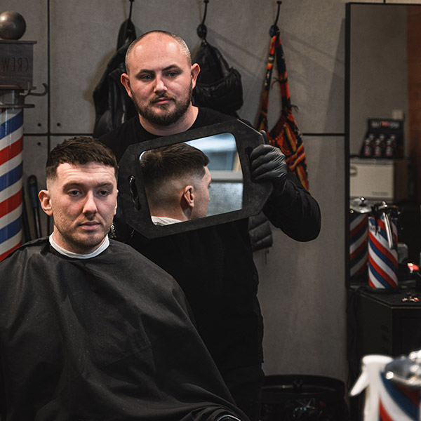Barber & Co holding mirror